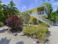 Secluded and private CBS canalfront 2 story home on