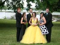 Canary yellow prom dress that has been dry cleaned and