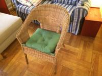 IKEA cane chair with a green cushion. Sparingly used