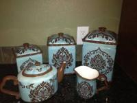 blue and brown 3 piece canister set with a matching tea