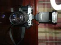 Cannon AE-1 Camera for sale. Model #4754451 with two