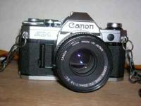 CANNON AE-1 CAMERA 1935 192 LENSES: 1) mounted on