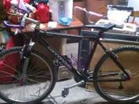 black and purple cannondale mountain bike for sale in