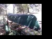 14' rogue river fiberglass canoe...used once ..in great