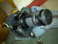 Great condition; telephoto lens included. Call John at