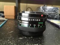 Used FD lens, Canon 50mm FD 1.8. Has a small obstuction