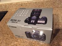 A BRAND NEW Canon EOS 5D Mark III body, never gotten of