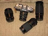 CANON AE-1 35 MM FILM CAMERA WITH FOUR LENSES, ONE