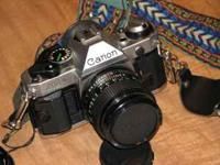 Vintage Canon AE-1 Film camera for sale with multiple