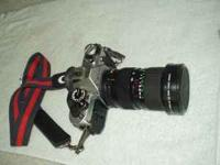 This is a Canon AE-1 35 mm film camera with a Canon