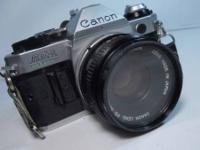 CANON AE-1 PROG 35mm FILM CAMERA IN WORKING CONDITION.