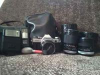Canon AE-1 SLR 35mm film camera with 50mm lens, 28mm