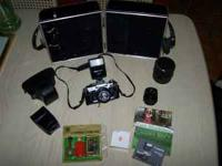 Canon AE-1Program 35mm SLR camera with 50mm lens and