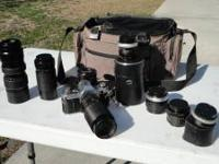 Canon AE1 film camera with lens and case. $100 firm.