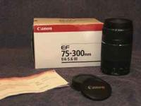 THIS IS A CANON EF 75-300MM TELEPHOTO LENS, IN