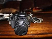 Canon EOS Rebel XS 1000D Camera with Battery Charger