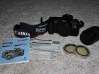 I have a Canon EOS Rebel G Camera with strap, 35-80 mm