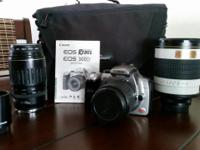Canon Eos Rebel w/18 - 55mm lens - auto focus Canon 100