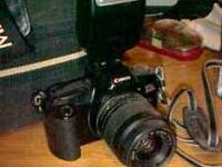 Canon EOS Rebel X 35 mm with extra cam bats call