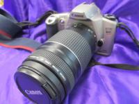 Canon EOS Rebel XSN 35mm film camera with two lenses