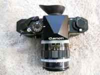 Canon F-1 black body with five factory Canon lenses,