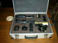 Nicely kept Canon AE-1 film camera with 4 lenses.: