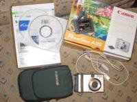 Comes with camera, all photo software, cables, original