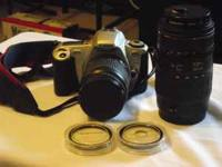 This listing is for a LIKE NEW Canon Rebel 2000 Kit -