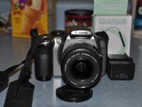 This is a Canon EOS Digital Rebel 6.1 mp camera with a