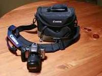 Canon EOS Rebel K2 with camera strap, 28-90 mm lens and