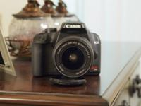 Canon Rebel XS DSLR with 18 - 55mm lens. Camera and