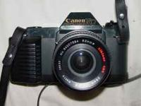 - Canon T 50 35mm SLR Film Camera with 52mm Lens - $50