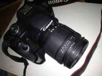 Canon T1i. with 28-105 lens excellent condition. Shoots