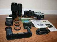 For sale is a Canon T50 kit + a non working Canon AE-1.