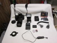 Canon 60D with a 28 to 135 lens, extra battery, 2 16G
