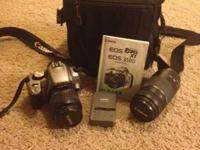 Canon EOS Digital Rebel XT Camera with long lens,