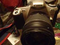 Canon Rebel 2000 EOS -strap & all- with a zoom lens EF