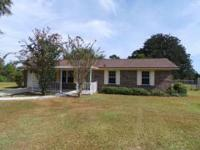 Cute country design home in Cantonment. Home features a