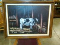 This is a canvas framed cow painting in great
