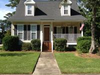 Low country, coastal cottage on corner lot in one of