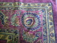 This is a gently used Capel brand area rug.  It is 7'