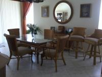 "Like new 42'/62"" Glass top table, 2 arm chairs, 2 side"