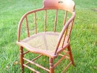 This older authentic 1930s Captains Chair exhibits an