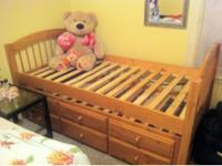Captain twin bed had 3 under drawers the color its