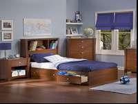 Twin bed frame with 3 drawers and bookcase headboard.