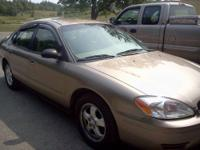 For sale, gold 2006 Ford Taurus. good to Very good