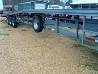 1998 triple axle, 50 ft, metal floor car hauler. Can