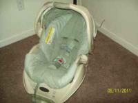 graco car seat for sale. Greenish white in color. Base