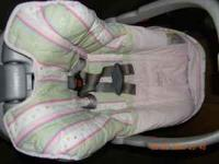 pink car seat with base. and tan car seat with base.