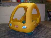 This is a very cute plastic car bed for a young one.